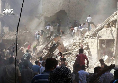 Syrians inspect the rubble of damaged buildings due to heavy shelling by Syrian government forces / AP