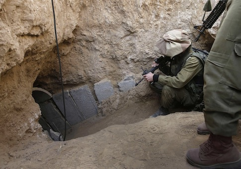 Israeli soldiers enter a tunnel discovered near the Israel Gaza border / AP