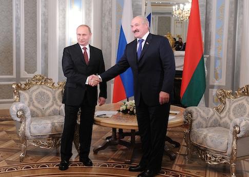 Belarusian President Alexander Lukashenko with Russian President Vladimir Putin / AP