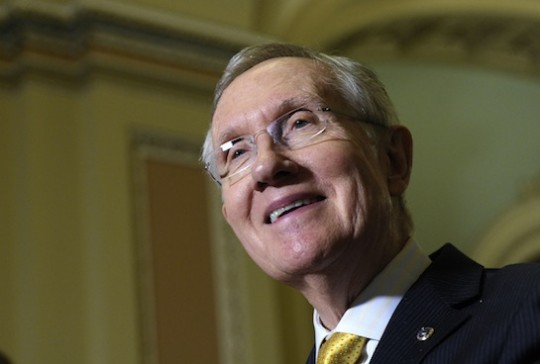 Koch-funded multi-millionaire and Senate Majority Leader Harry Reid thinks about money and smiles. (AP)