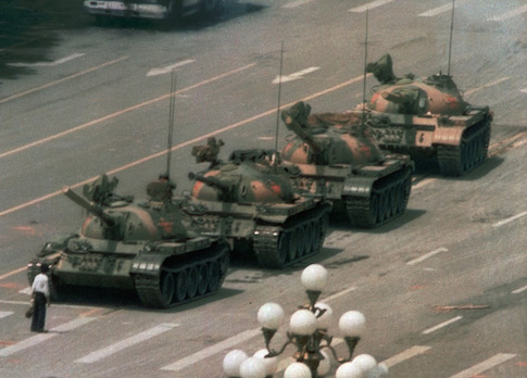 A Chinese man stands alone to block a line of tanks in Tiananmen Square on June 5, 1989. / AP