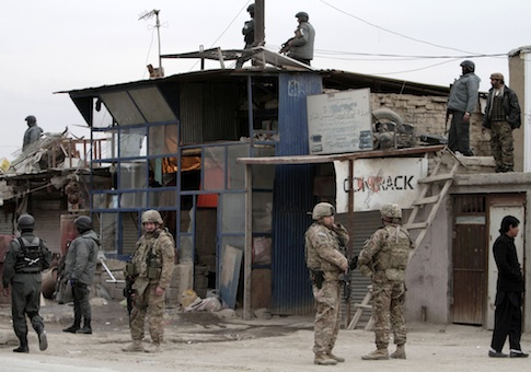 Afghan police and U.S. forces respond to a suicide car bomb attack on the Jalalabad-Kabul road in Kabul De. 27, 2013