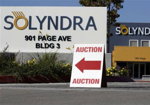 An auction sign outside the headquarters of Solyndra, which declared bankruptcy in 2011. / AP