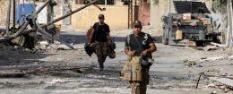Iraqi counterterrorism forces walk in Falluja