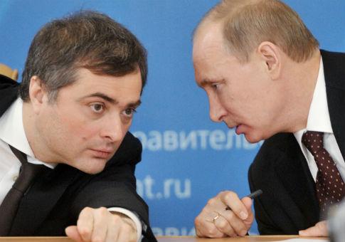 Russian leader Vladimir Putin, right, speaks to aide Vladislav Surkov / AP