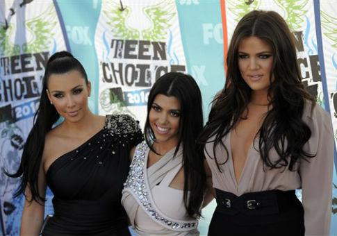 From left, Kim Kardashian, Kourtney Kardashian, and Khloe Kardashian / AP