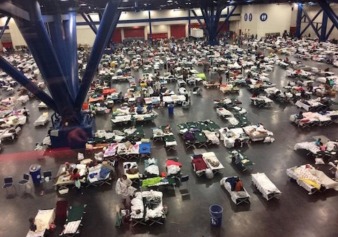 Evacuees take shelter from Tropical Storm Harvey in the George R. Brown Convention Center in Houston
