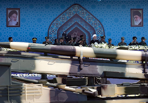 An Iranian medium range missile Zelzal passes by Iranian President Hassan Rouhani during the annual military parade